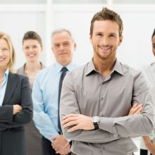 19339108 - portrait of young businessman with business team
